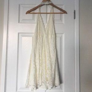 Cream lace halter top dress.